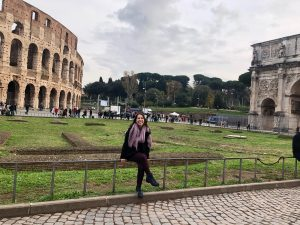 Girl in front of the Colosseum